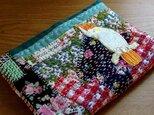 なみなみ縫いぬい - ちょっぴりいびつな文庫本ブックカバー(オウム)の画像