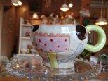 お花畑のマグカップの画像