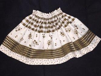 子供ギャザースカート/オフホワイト×茶色のシックな柄の画像