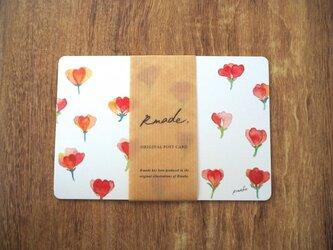 赤い小花のポストカードの画像