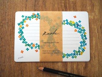 青い小花のポストカードの画像
