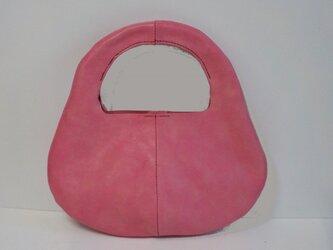 手縫い ピンクの牛革で出来た、ワンハンドバッグの画像