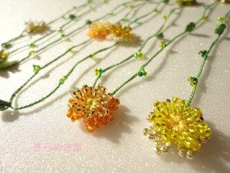 春の野原 黄・オレンジ・緑色のお花ラリエット の画像