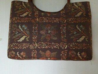 帯と皮の丸い手でバッグの画像