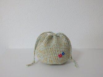コロンと小さな編み巾着 砂浜の画像
