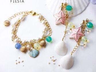 【予約販売】ピンクスターフィッシュと貝殻のサマーピアス(イヤリング可)の画像
