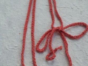 あかね色の綿の紐と小玉の画像