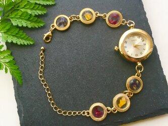 ゴールドフレームの花時計の画像