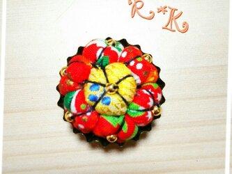 缶に入ったX'mas模様の花のマグネットの画像
