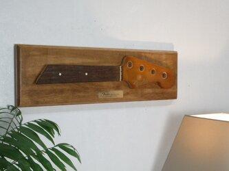 ギターヘッドの壁掛けの画像