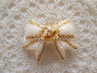 小さなリボン【金色星】の画像
