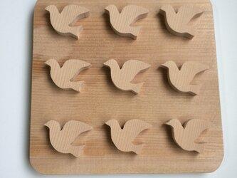 鳥の鍋敷きの画像