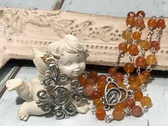 ミックスオレンジカルセドニーのロザリオの画像