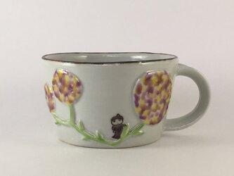 花のマグカップの画像