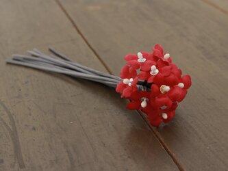 あかい小花のコサージュの画像