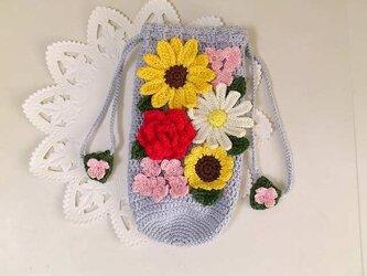 お花モチーフいっぱいのペットボトルカバー/500mlの画像