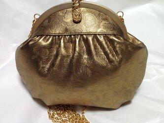 アンティークゴールドのバッグの画像