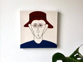 ファブリックパネル  煙草をふかす男 30×35の画像