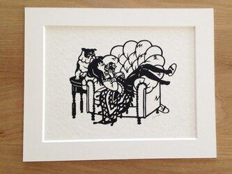 犬の切り絵「プレゼント」の画像