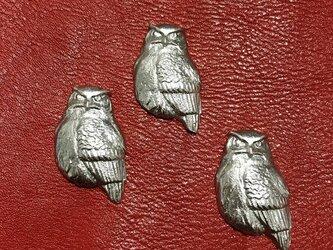 財布に入るフクロウの画像