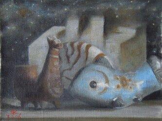 魚とメキシコの置き物とオウム貝の画像