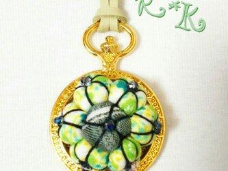 懐中時計の花のネックレスの画像