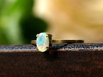 K18エチオピア産オパールのファセットオーバルカット爪留めリング ~Irisの画像