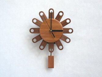 フラワー振子時計(丸穴)の画像