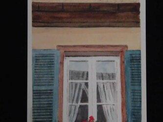 窓辺の花の画像