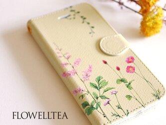 ピンクの花たちのスマホケース手帳型の画像