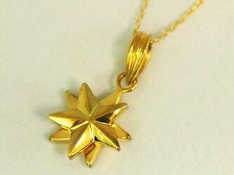 回転する金星のペンダント【送料無料】くるくる回りながら流れ落ちるゴールドスターをイメージした首飾りですの画像
