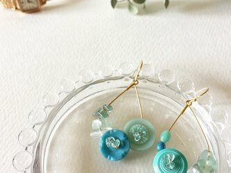 Ocean color buttons pierceの画像