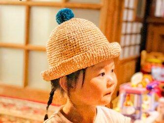 ポンポン付の麦わら帽子《大人サイズ》の画像