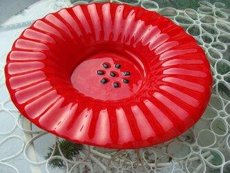 赤いガラスのポピーの画像