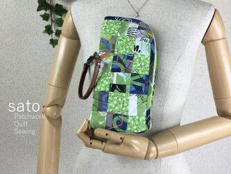 【ジャンク品】パッチワークのペットボトルケース 緑の画像