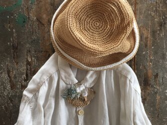 忘れな草いっぱいの籠.......suMire-bouquet 布花コサージュの画像