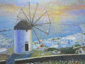 ポニ-の風車と夕日の画像