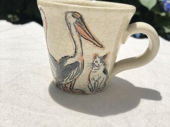 ペリカンと猫のカップの画像