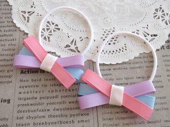 ★再販・りぼん★ ピンク・むらさき・水色の細めのトリプルリボンのヘアゴムの画像