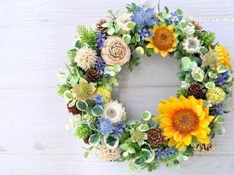 再販3 向日葵と青い小花のリース:木の実 オレンジ ブルー 夏の画像