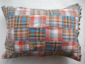 リボン付きかわいいパッチワークオレンジ枕カバーの画像