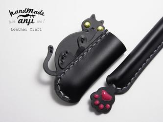 幸運の使者 まったり黒猫のボールペンカバー肉球付きの画像