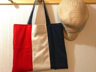 キャンバス地・トリコロールのバッグの画像
