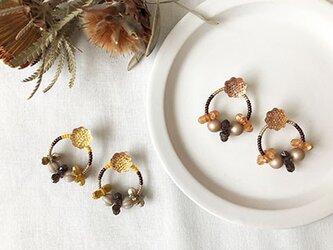 ring ring bromma - pumpkin:花リングのピアス(パンプキン)の画像