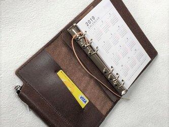 バイブル 筒状ペンホルダーのシステム手帳 ヌメ床革 焦げ茶 レザー 手帳 ノートの画像