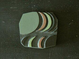 小さい木彫手鏡(echo)夜色の画像