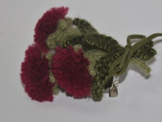毛糸の花コサージュ・エンジの画像