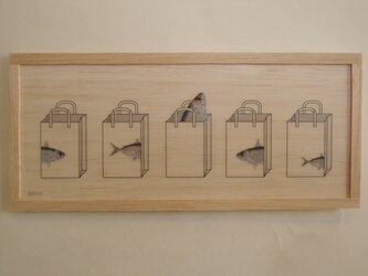 Fish and paper bagの画像