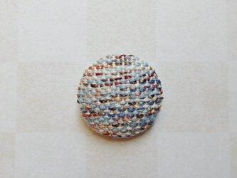 春めく手織りのブローチの画像