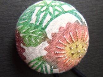 紅型染めの髪留め(伊勢型紙・橙色の花)の画像